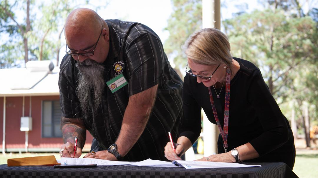 Acting CEO Malcolm Darling and CAAPS CEO Jill Smith signing the agreement